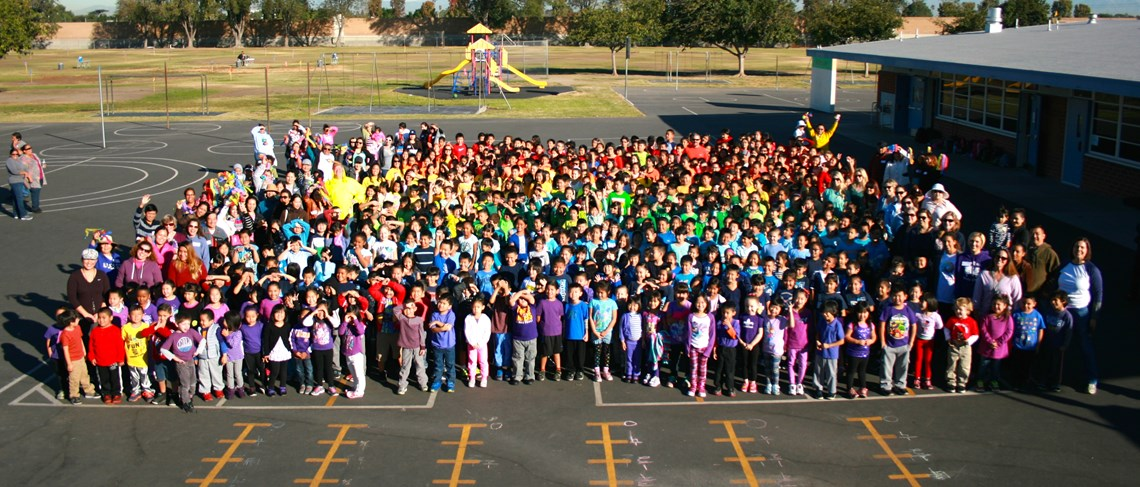 Students pose for a photo after their Rainbow Run organized by the PTA to support field trips, assemblies and a positive school culture.
